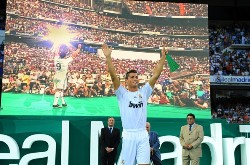 Cristiano Ronaldo's Real Madrid Presentation: Former Manchester United star Cristiano Ronaldo enjoys his Real Madrid presentation. CR9 raises his arms as he salutes the 80,000 supporters that attented this unprecedented event at the Santiago Bernabeu.