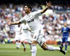 Spanish La Liga, Real Madrid 5-0 Xerez: Cristiano Ronaldo celebrates with his arms wide open after scoring against Xerez.