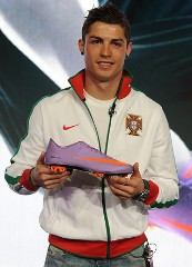 Cristiano Ronaldo carrying one Nike Mercurial Vapor Superfly II boot during its launch by Nike in London, on February 24, 2010.