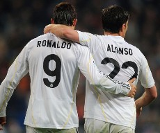 La Liga; Real Madrid 6-2 Villarreal: Cristiano Ronaldo joins Xabi Alonso in celebration after the Spanish midfielder scores Real Madrid's sixth goal from the penalty spot.