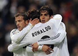 La Liga; Real Madrid 6-2 Villarreal: Cristiano Ronaldo is congratulated and hugged by team mates Ricardo Kaka and Rafael Van der Vaart after scoring from a free-kick against Villarreal.