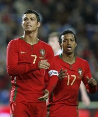 Portugal captain Cristiano Ronaldo celebrates, Luis Nani runs behind him to join in the celebration.