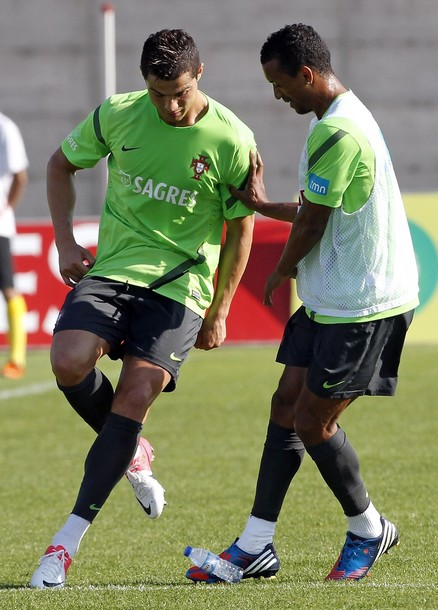 Portugal's Ronaldo plays with a bottle of water with teammate Nani during a training session in prepration for Euro 2012 at Obidos village stadium