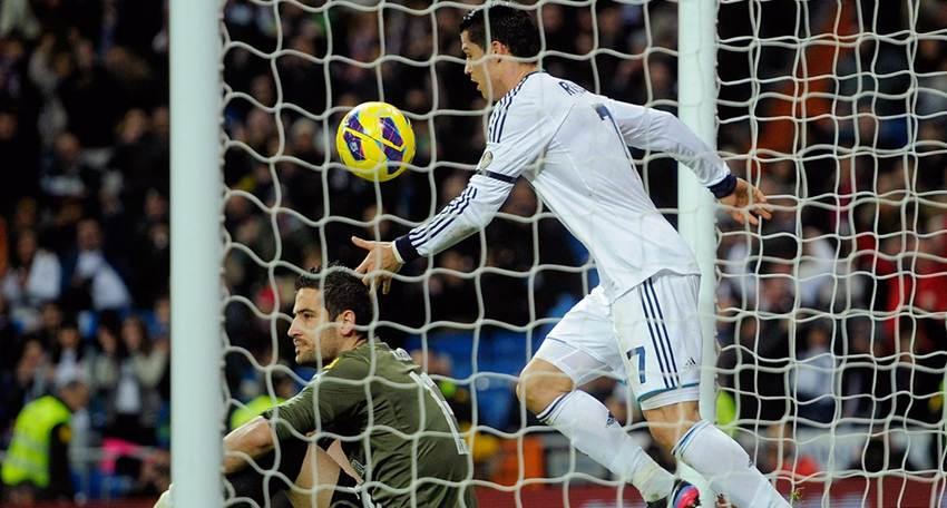 Cristiano Ronaldo of Real Madrid CF celebrates scoring their first goal close to goalkeeper Francisco Casilla of RCD Espanyol during the La Liga match between Real Madrid CF and RCD Espanyol at Estadio Santiago Bernabeu on December 16, 2012 in Madrid, Spain.
