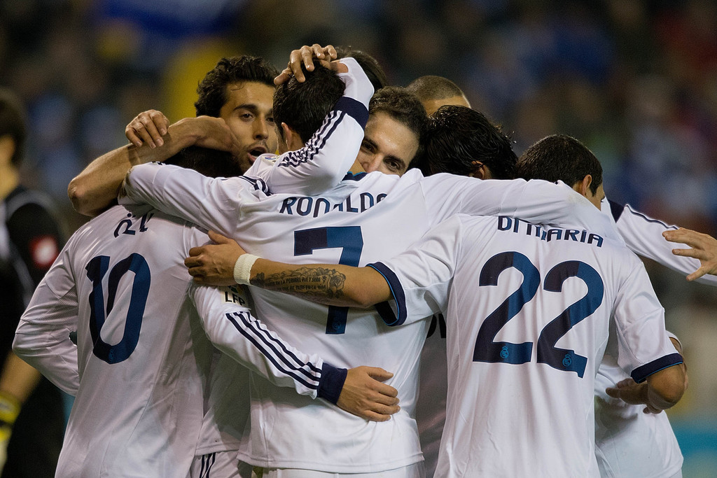Gonzalo Higuain (3dR) of Real Madrid CF celebrates scoring their second goal with teammates Mezut Ozil (L), Alvaro Arbeloa (2ndL), Cristiano Ronaldo (3dL) and Angel Di Maria (R) during the La Liga match between RC Deportivo La Coruna and Real Madrid CF at Riazor Stadium on February 23, 2013 in La Coruna, Spain.