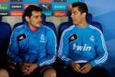 Iker Casillas (L) and Cristiano Ronaldo of Real Madrid CF chat as they sit on the bench during the La Liga match between RCD Espanyol and Real Madrid CF at Cornella-El Prat Stadium on May 11, 2013 in Barcelona, Spain.