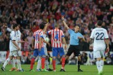 Cristiano Ronaldo (L) of Real Madrid is sent off by referee Carlos Clos Gomez during the Copa del Rey Final between Real Madrid CF and Club Atletico de Madrid at Estadio Santiago Bernabeu on May 17, 2013 in Madrid, Spain.
