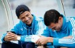 Cristiano Ronaldo (L) of Real Madrid CF listens to music with teammate Pepe (R) on their cell phones prior to start the La Liga match between Real Sociedad de Futbol and Real Madrid CF at Estadio Anoeta on May 26, 2013 in San Sebastian, Spain.