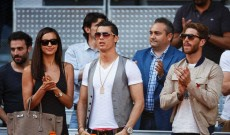 (L-R) Irina Shayk (L) her boyfriend Real Madrid player Cristiano Ronaldo (C) and Real Madrid player Sergio Ramos stand at the end of the match between Rafael Nadal and David Ferrer of Spain on day seven of the Mutua Madrid Open tennis tournament at the Caja Magica on May 10, 2013 in Madrid, Spain.