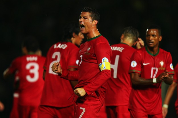 Cristiano Ronaldo of Portugal celebrates scoring during the FIFA 2014 World Cup Qualifying Group F match between Northern Ireland and Portugal at Windsor Park on September 6, 2013 in Belfast, Northern Ireland.